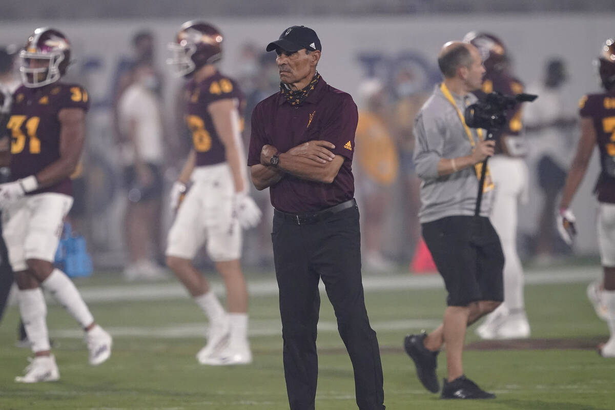 Arizona State head coach Herm Edwards watches warm ups prior to an NCAA college football game a ...