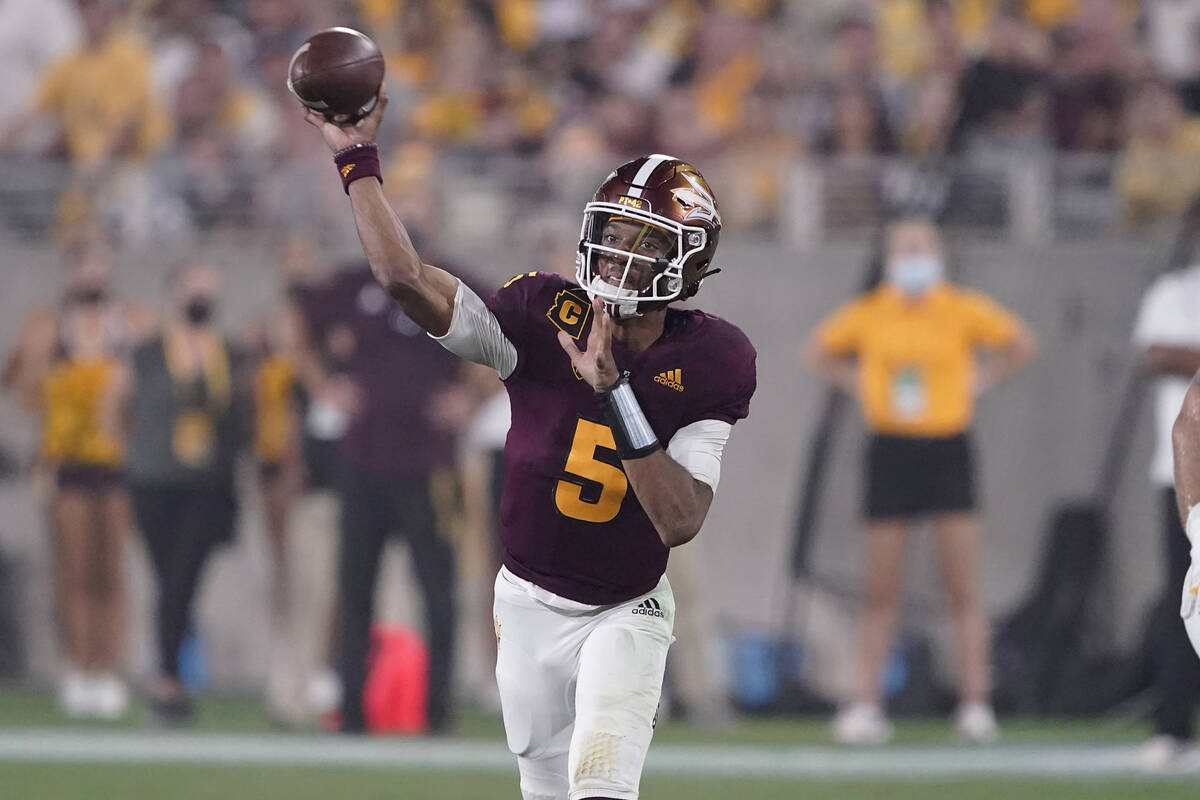 Arizona State quarterback Jayden Daniels (5) throws against UNLV during the first half of an NC ...