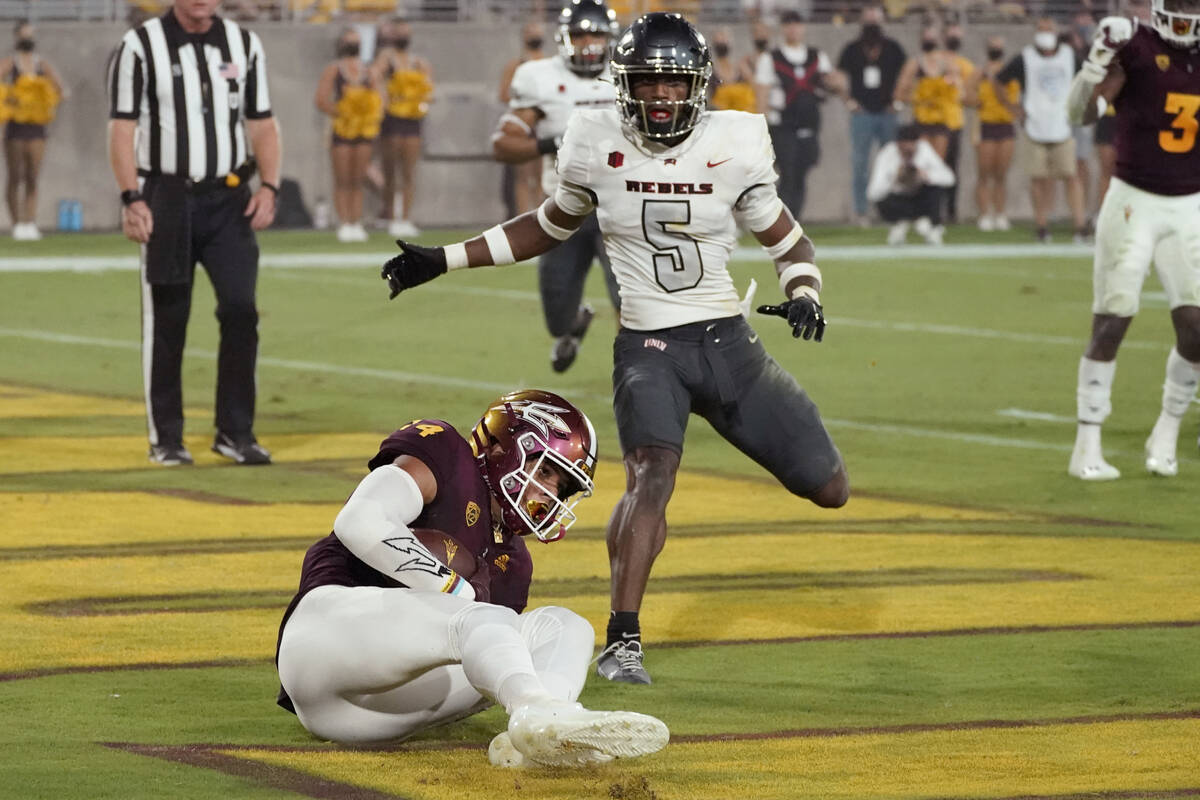 Arizona State wide receiver Johnny Wilson (14) pulls in a touchdown as UNLV defensive back Phil ...