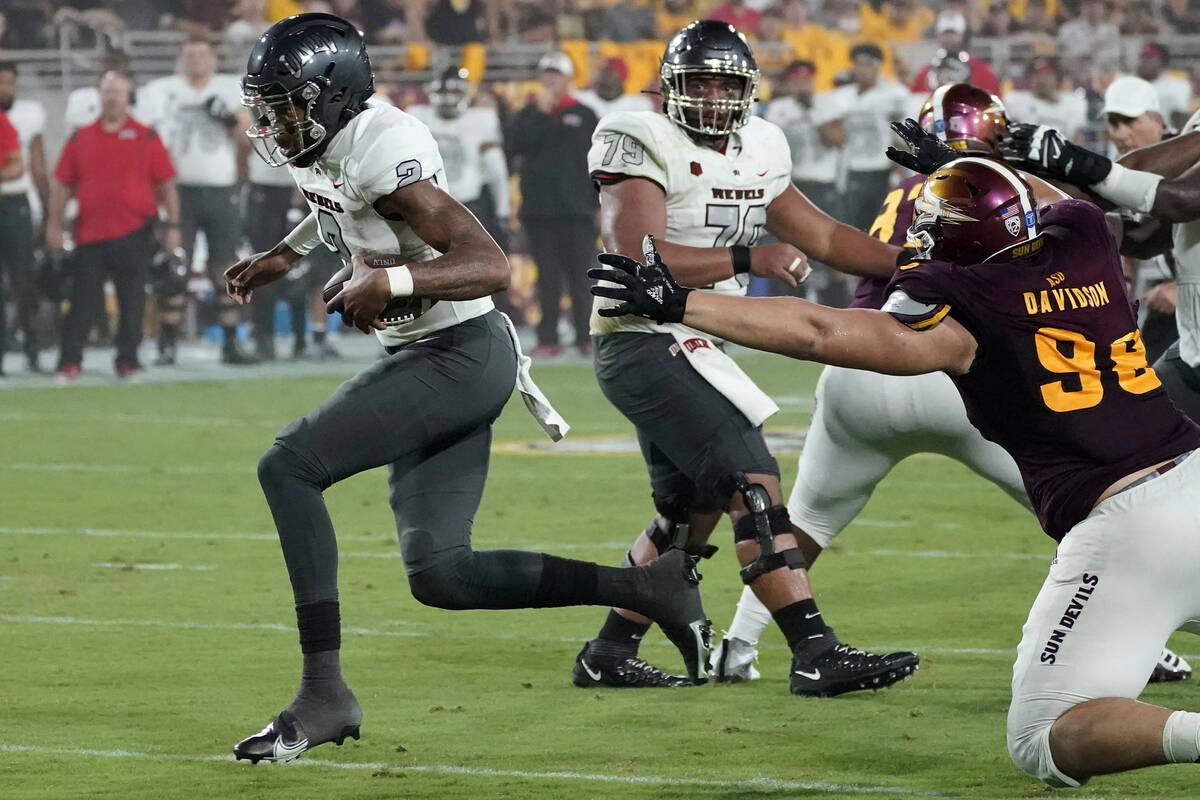 UNLV quarterback Doug Brumfield (2) runs for a touchdown against Arizona State during the first ...