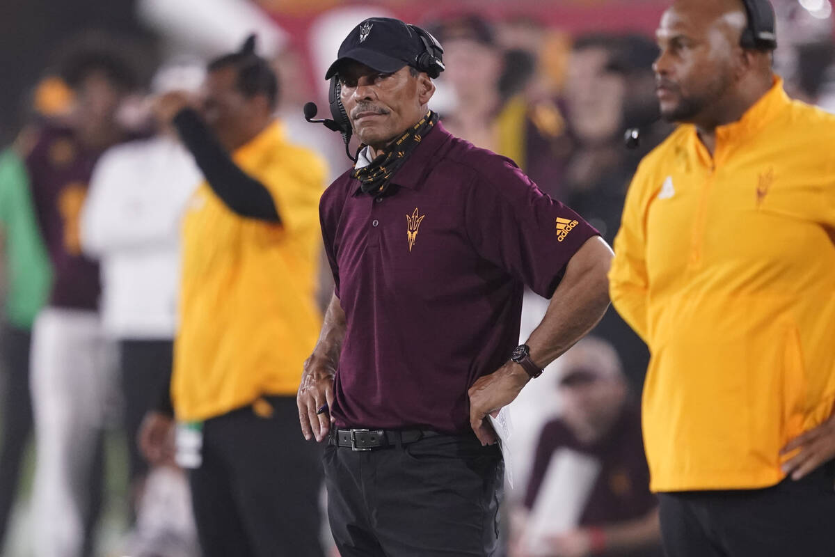 Arizona State head coach Herm Edwards watches his team during the first half of an NCAA college ...