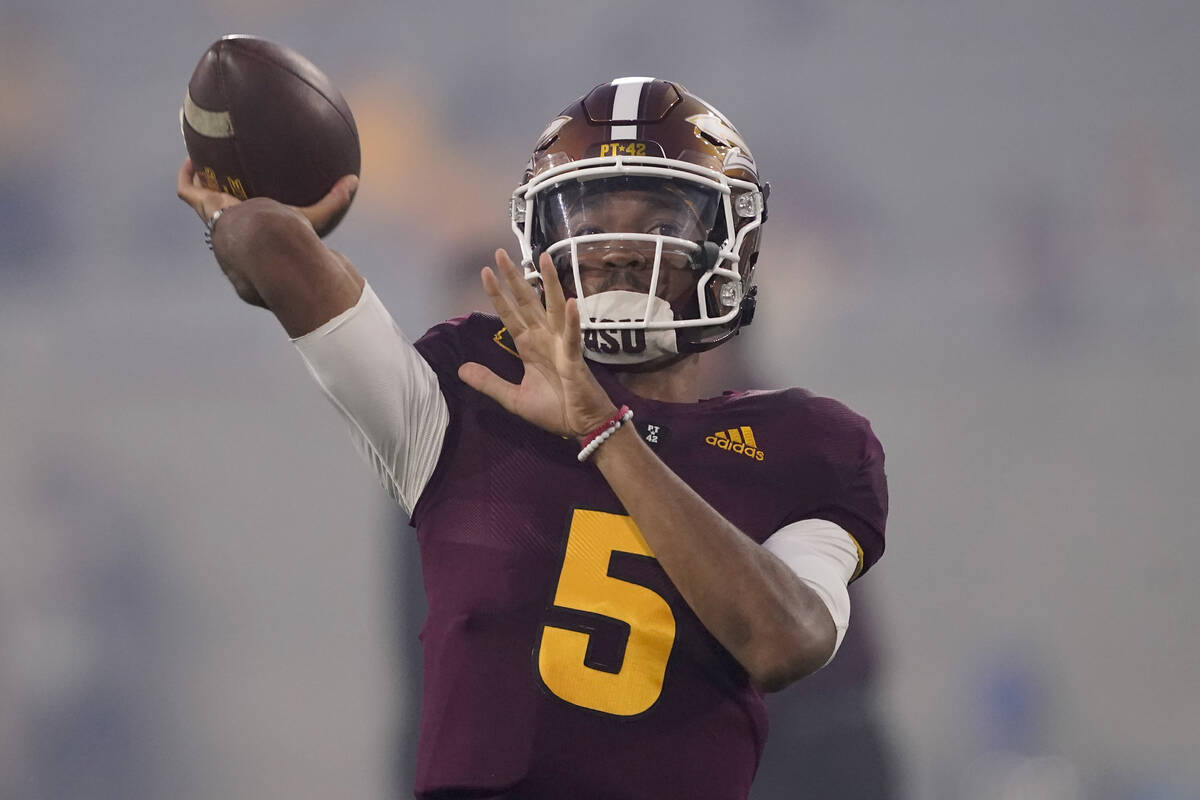 Arizona State quarterback Jayden Daniels (5) warms up prior to an NCAA college football game ag ...