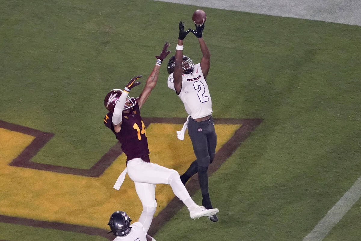 UNLV defensive back Nohl Williams (2) intercepts a pass in the end zone intended for Arizona St ...