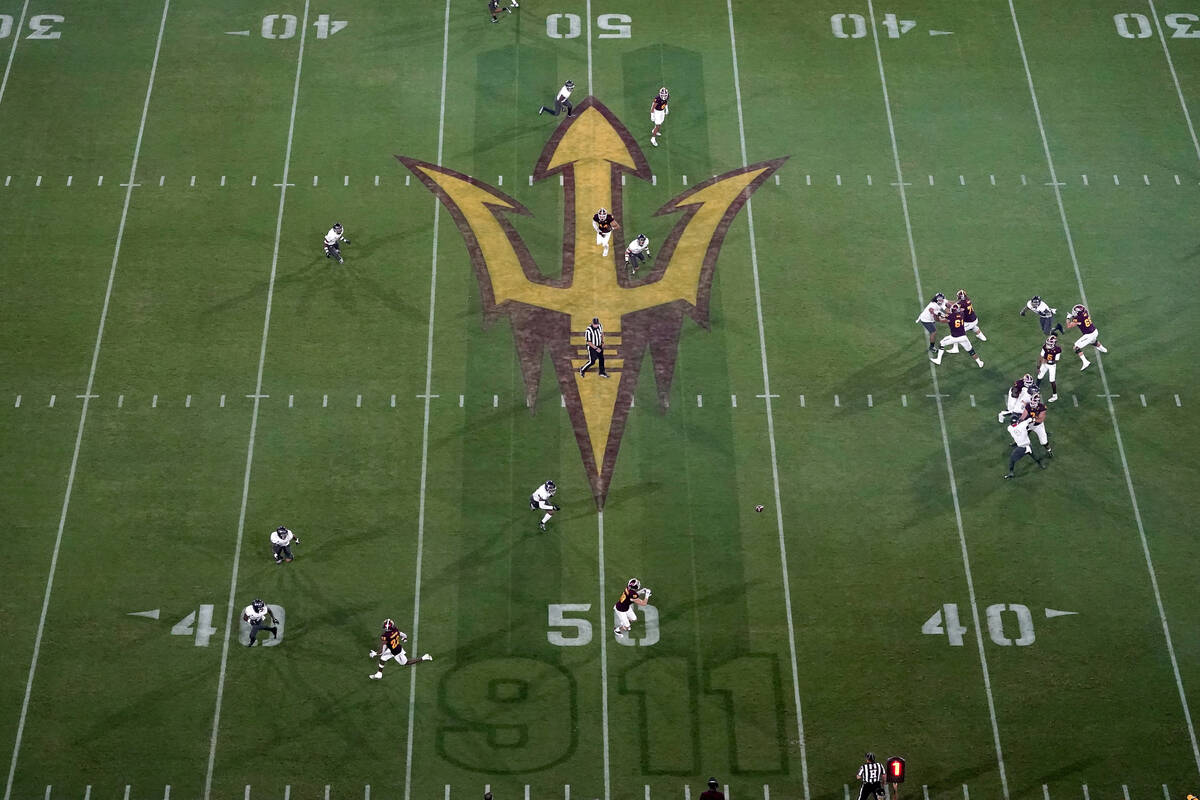 A Sept. 11 memorial is shown on the field during the first half of an NCAA college football gam ...