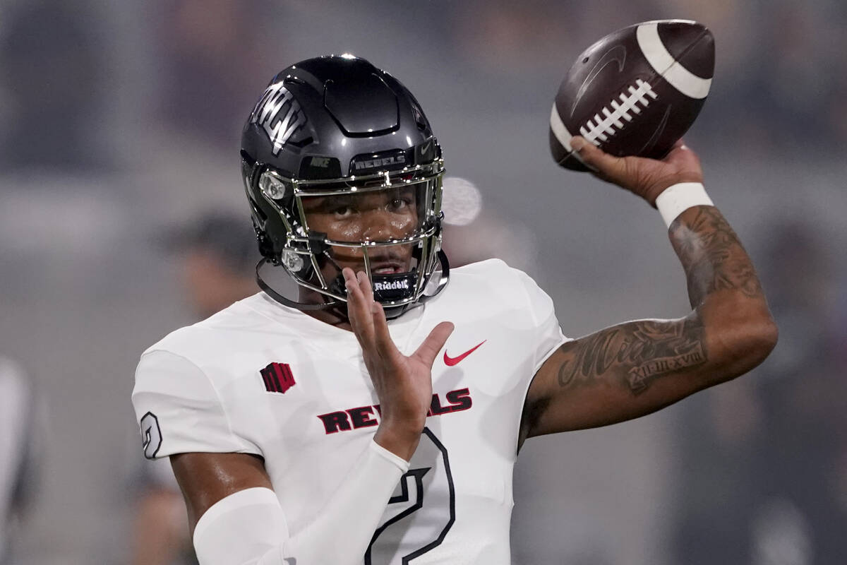 UNLV quarterback Doug Brumfield (2) warms up prior to an NCAA college football game against Ari ...