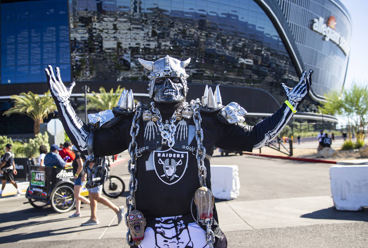 Brian McComb, of Washington, poses for a picture before an NFL game between the Raiders and the ...