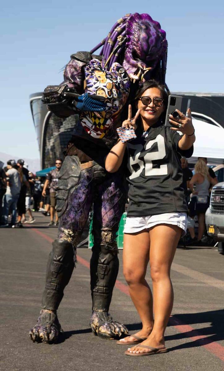 Raidertor with Yumi Yamaato, of Las Vegas, tailgate before an NFL football game between the Rai ...