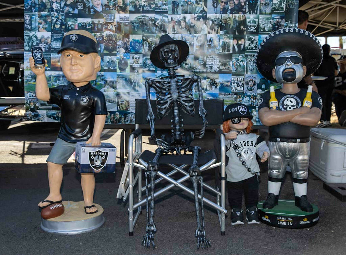 Tailgate decorations on display before an NFL football game between the Raiders and Baltimore R ...