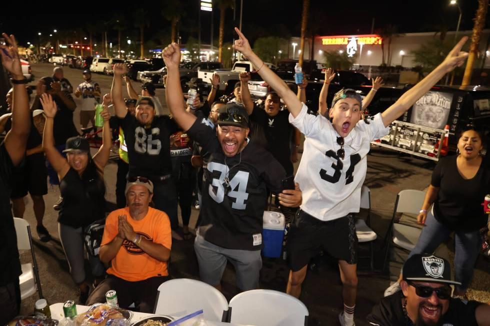 Raiders fans celebrate the team's 33-27 win over the Baltimore Ravens outside Allegiant Stadium ...