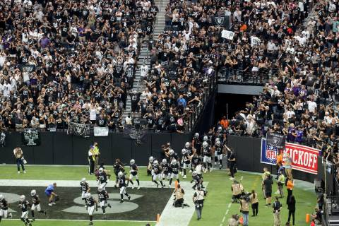 Fans cheer as the Raiders take the field to host the Baltimore Ravens on ÒMonday Night Footbal ...