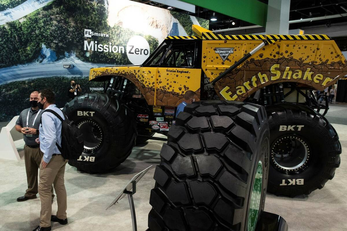 Earthmax SR41 tire is displayed at Earth Shaker booth during the opening day of the National Mi ...