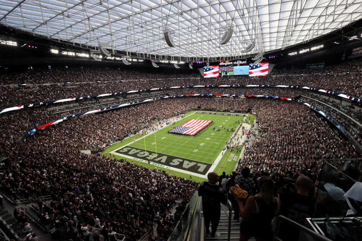 """Fans stand for the National Anthem before the Raiders take on the Baltimore Ravens on """"Monday N ..."""
