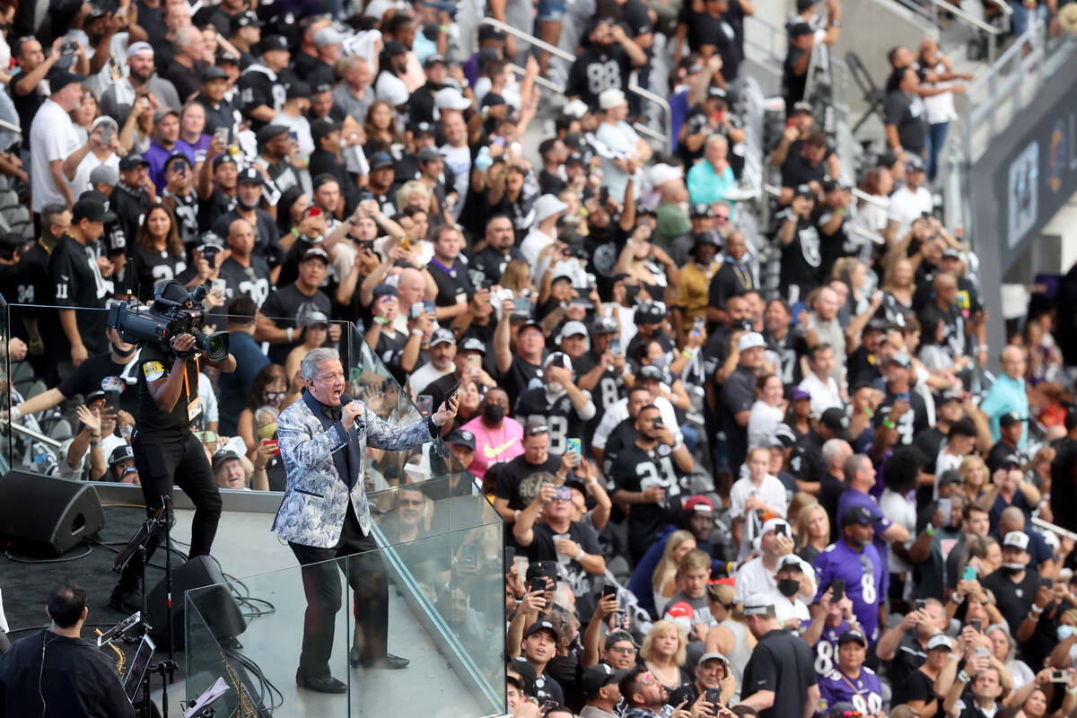 """Fans cheer as Bruce Buffer introduces the Raiders the Baltimore Ravens on """"Monday Night Footbal ..."""
