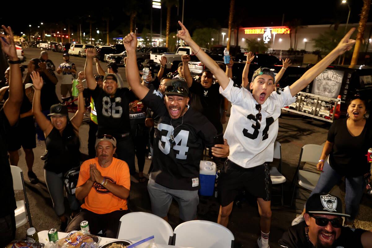 "Tailgating fans, including Marcus Camarena, right, and Tony ""Tony Vegas"" Ocoro, both of Las Veg ..."
