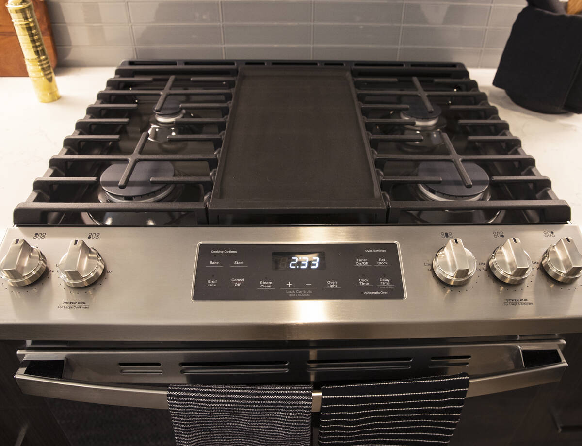 Stainless steel range is shown in a one-bedroom apartment at Auric Symphony Park, the first lux ...