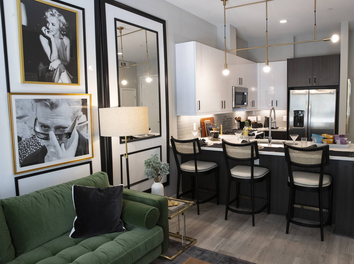 A living room and a kitchen area are seen in a one-bedroom apartment at Auric Symphony Park, th ...