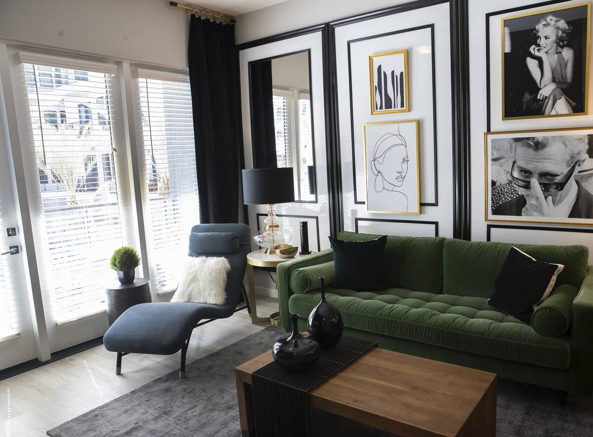 A living room is seen in a one-bedroom apartment at Auric Symphony Park, the first luxury multi ...