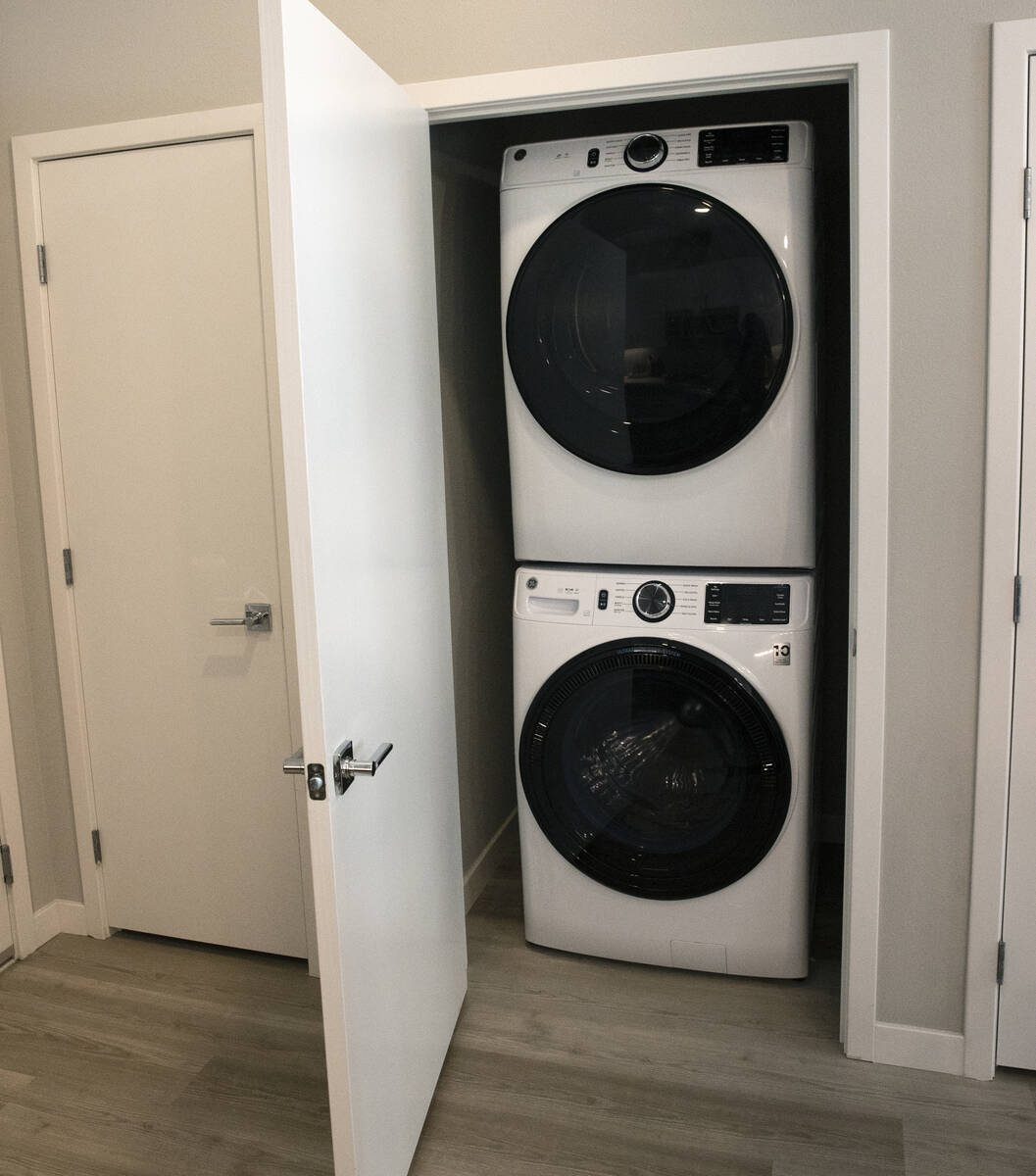 A laundry room is seen in a one-bedroom apartment at Auric Symphony Park, the first luxury mult ...