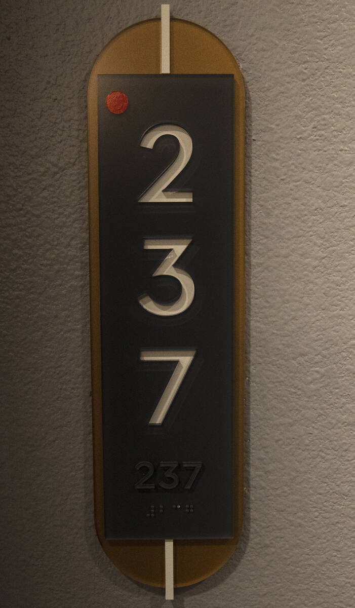 Room number sign is seen outside a one-bedroom apartment at Auric Symphony Park, the first luxu ...