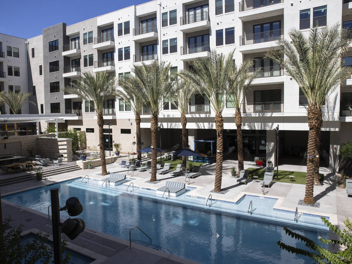 Swimming pool area as seen from the second floor apartment balcony at Auric Symphony Park, the ...