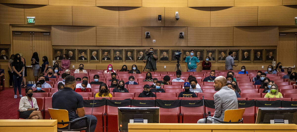 The RaidersÕ Solomon Thomas, left, and Dr. Sheldon Jacobs speak with participants during a ...