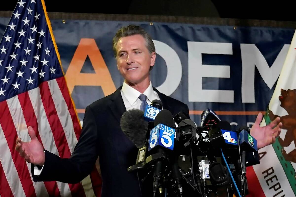 California Gov. Gavin Newsom addresses reporters after beating back the recall attempt that aim ...