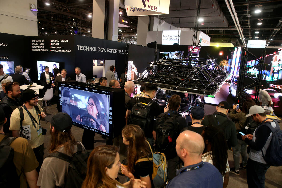 """A conventioneer checks out an """"enhanced environment"""" inside a car in the production e ..."""