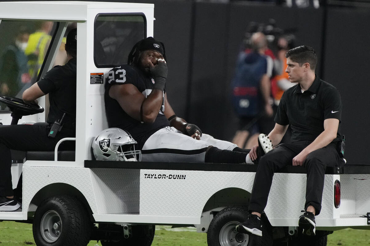 Las Vegas Raiders defensive tackle Gerald McCoy (93) is taken off the field during the second h ...