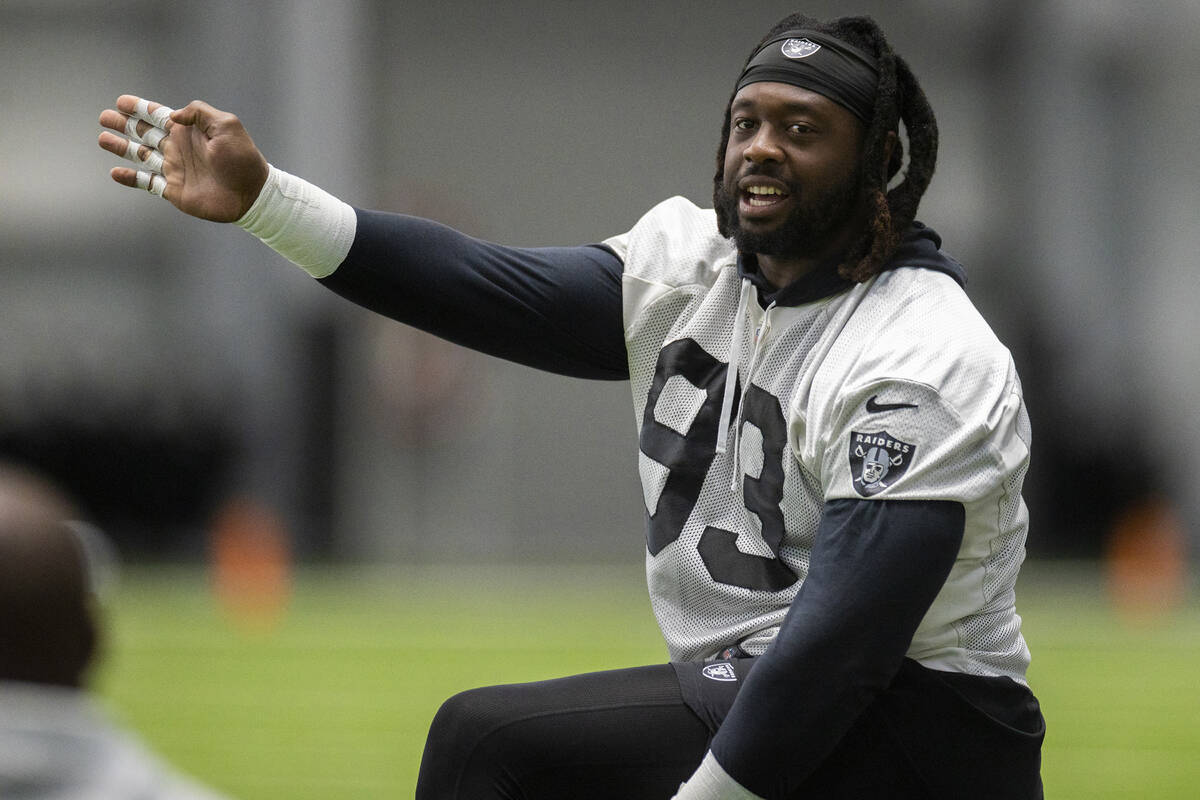 Raiders defensive tackle Gerald McCoy (93) stretches before the start of practice on Saturday, ...