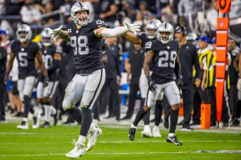 Raiders defensive end Maxx Crosby (98) celebrates a defensive stoppage during the third quarter ...