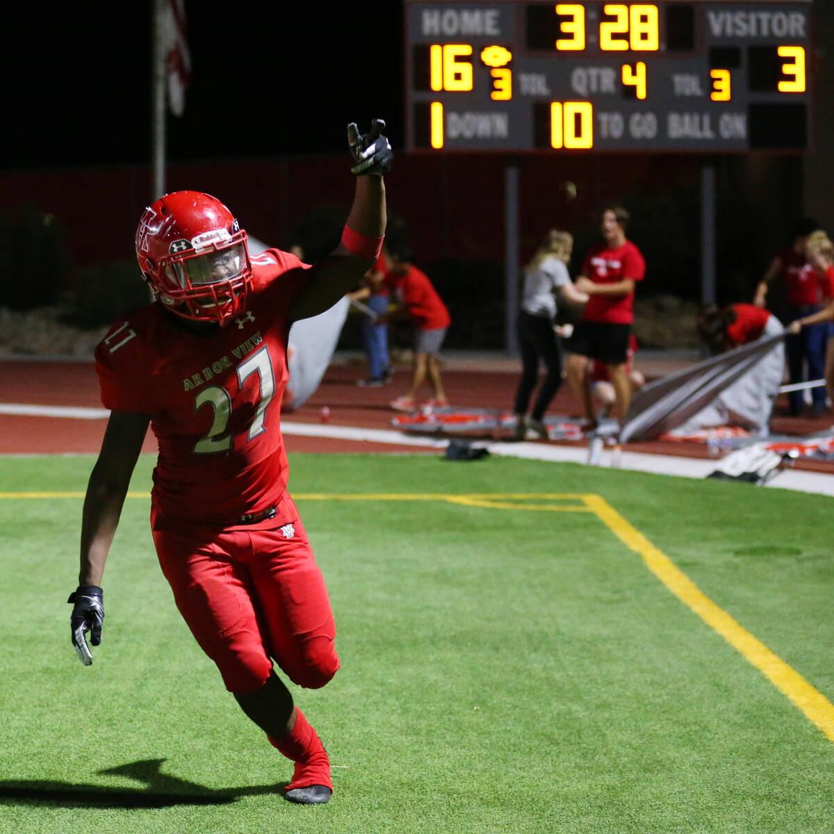 Arbor View's Makhai Donaldson(27) celebrates a touchdown during the fourth quarter of a footb ...