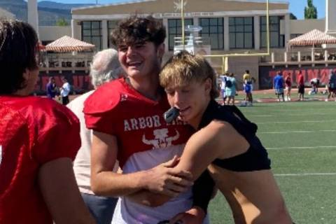 Christian Thatcher, left, a freshman linebacker at Arbor View, receives congratulations from Pa ...