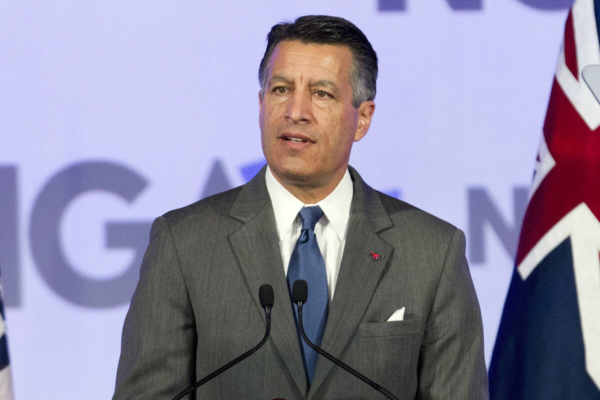 FILE - This Feb. 24, 2018, file photo shows then-Gov. Brian Sandoval of Nevada at the National ...
