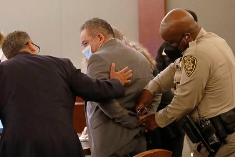 Attorney Christopher Oram, left, talks to Omar Rueda-Denvers, center, after Rueda-Denvers was f ...