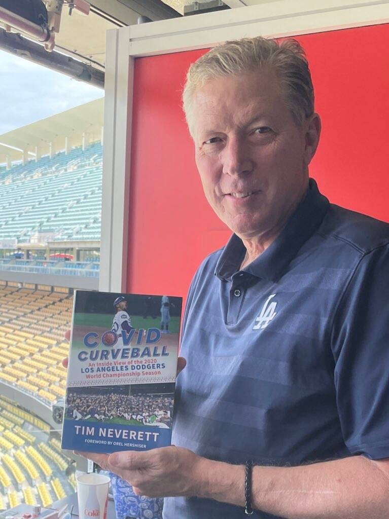 Former Dodgers pitching great Orel Hershiser holds a copy of Tim Neverett's book about the Dodg ...