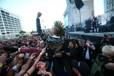 An attendee crowd surfs during the first day of the Punk Rock Bowling music festival in downtow ...