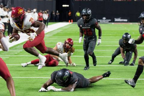 Iowa State Cyclones running back Breece Hall (28) runs with the ball as UNLV Rebels defenders, ...