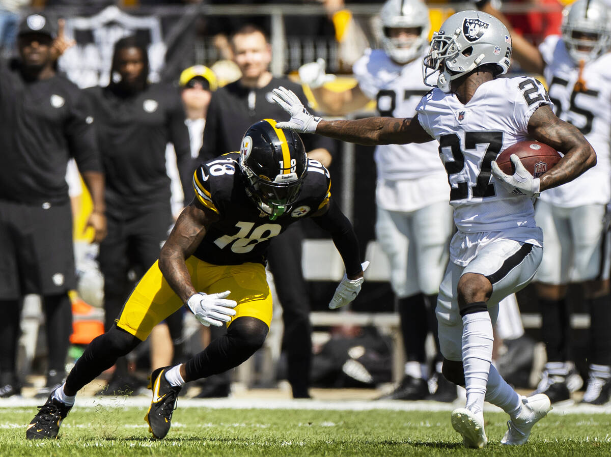 Raiders cornerback Trayvon Mullen (27) runs back an interception against Pittsburgh Steelers wi ...