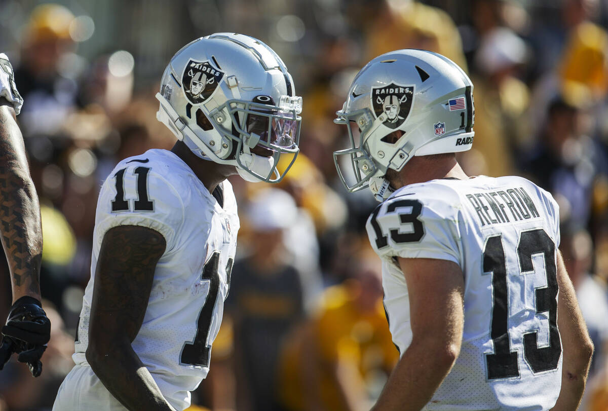Raiders wide receiver Henry Ruggs III (11) celebrates his 61-yard touchdown score with Raiders ...
