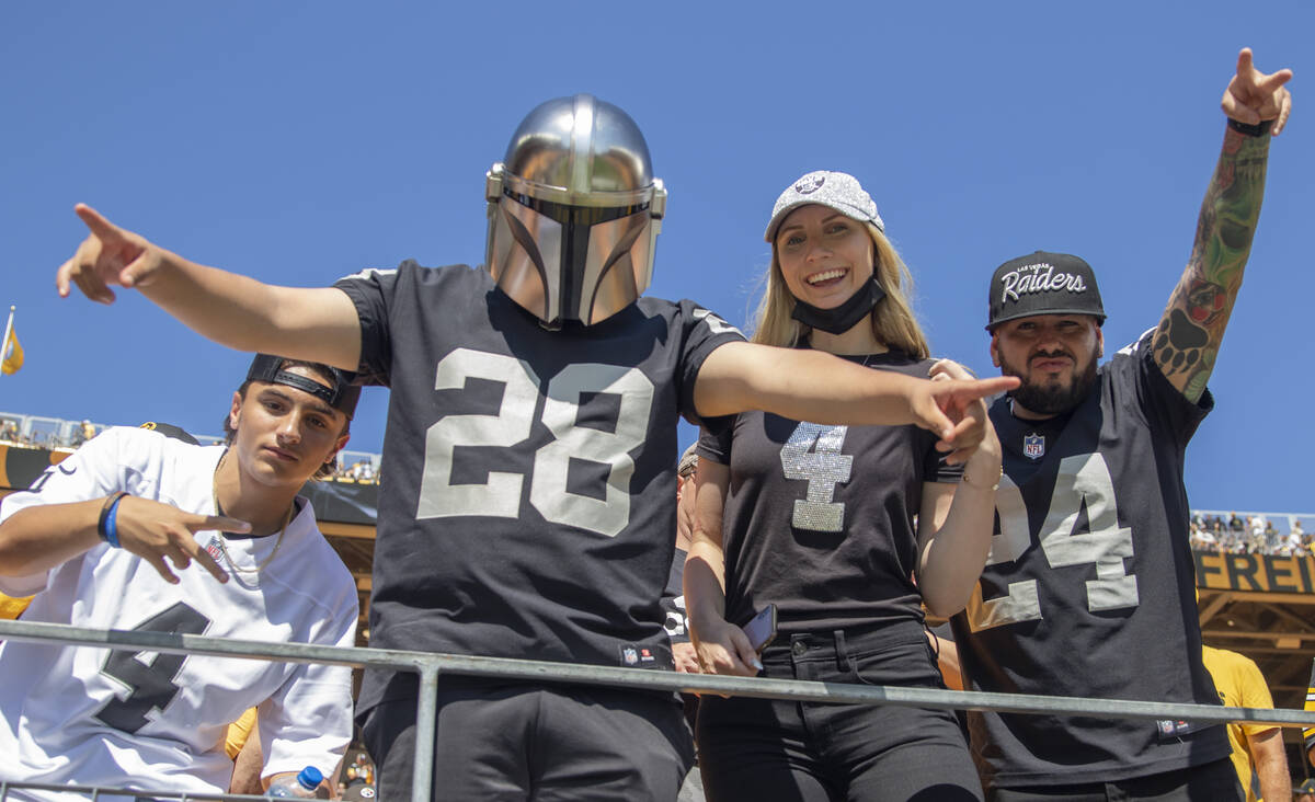 Raiders fans cheer the team on during warm ups before an NFL football game against the Pittsbur ...