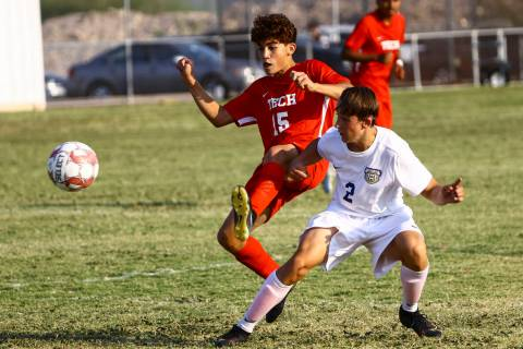 Southeast Career Tech's William Mowery (15) and Spring Valley's Drexle Neumann (2) fight for po ...