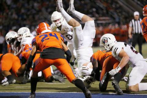 Bishop Gorman's Zion Branch (5) tackles Luke Durfey (5) for a touchback in the second quarter o ...