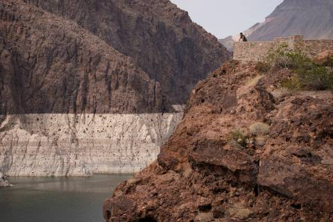 A person looks out over Lake Mead near Hoover Dam at the Lake Mead National Recreation Area in ...