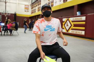 Ethan Lucero, 19, of Las Vegas, waits in observation after receiving the COVID-19 vaccine durin ...