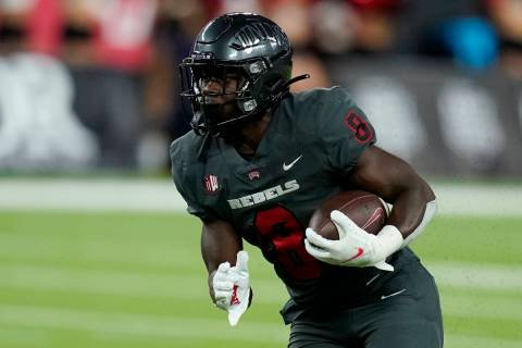 UNLV running back Charles Williams (8) plays against Iowa State during the second half of an NC ...
