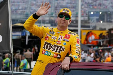 Kyle Busch waves to fans before a NASCAR Cup Series auto race at Bristol Motor Speedway Saturda ...