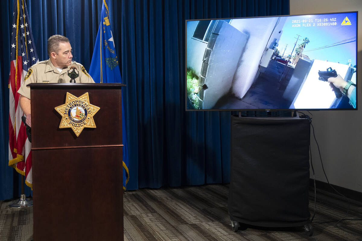 Assistant Sheriff Andrew Walsh shows body camera footage from the scene of a police shooting on ...