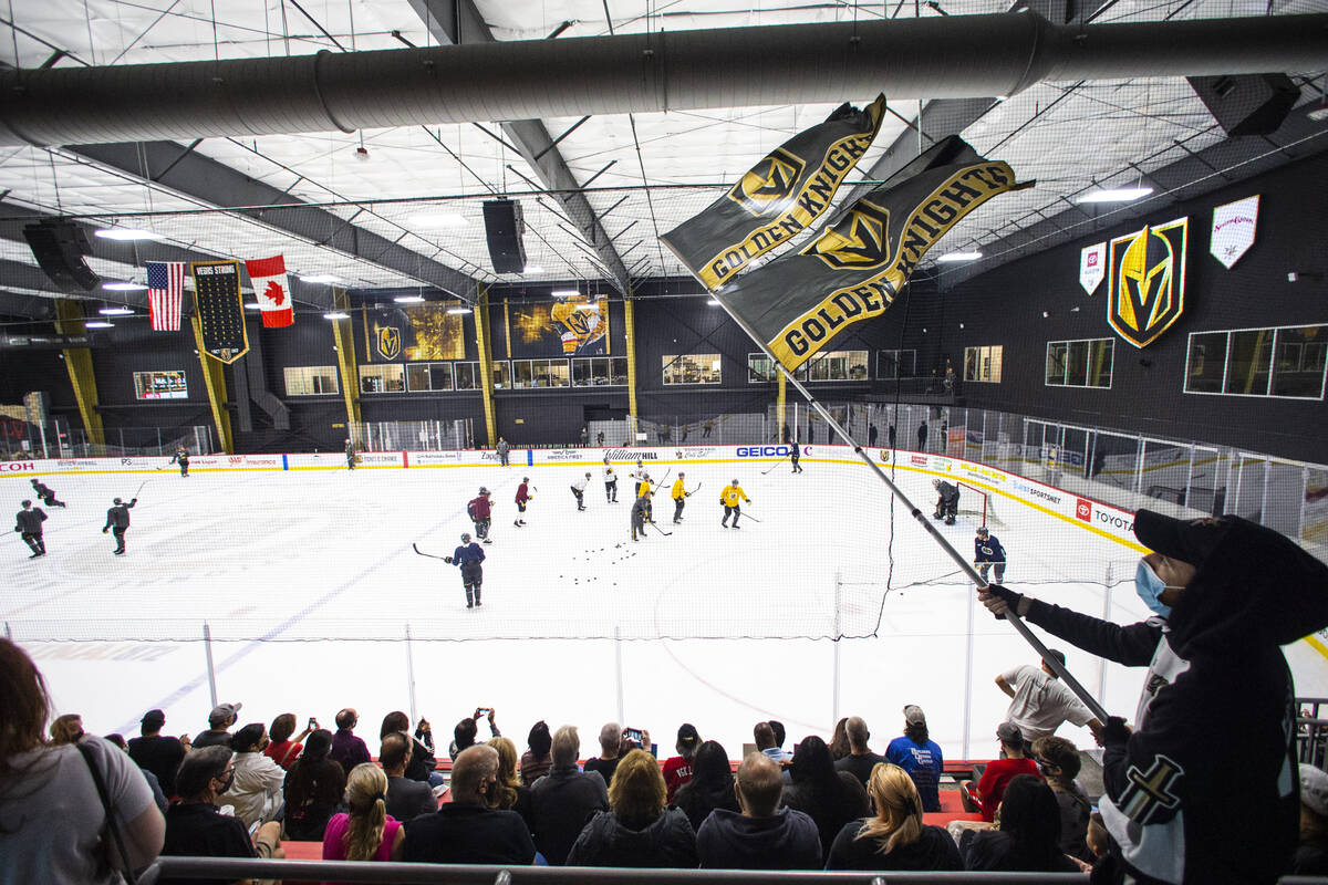 Golden Knights fan Matt Helfst, also known as ÒFlag Guy,Ó watches the action during t ...