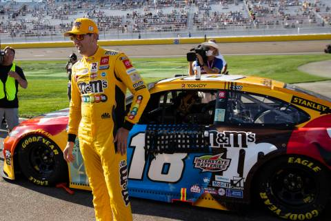 Kyle Busch (18) stands next to his car prior to the start of the 4th Annual South Point 400 rac ...
