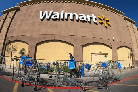 Shopping carts are lined up as barriers leading to the entrance of Walmart Supercenter, 3950 W ...